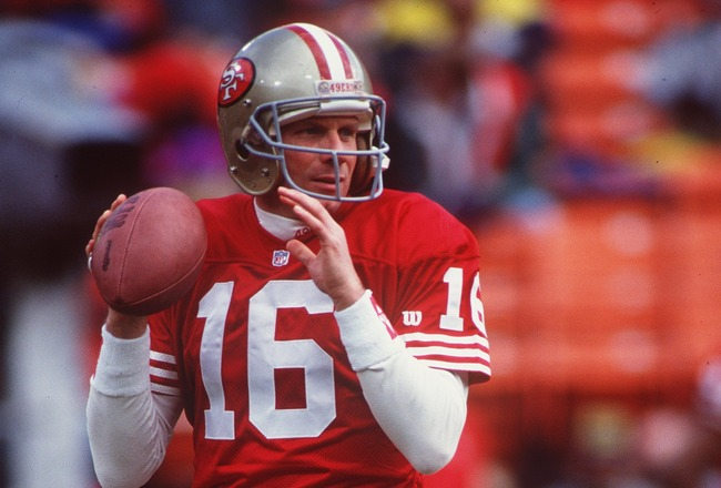 1990:  SAN FRANCISCO 49ERS QUARTERBACK JOE MONTANA SETS TO THROW DURING THE 49ERS 20-13 NFC DIVISION PLAY OFF WIN OVER THE WASHINGTON REDSKINS AT CANDLESTICK PARK IN SAN FRANCISCO, CALIFORNIA.   Mandatory Credit: Otto Greule/ALLSPORT