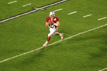 MIAMI, FL - JANUARY 03:  Quarterback Andrew Luck #12 of the Stanford Cardinal looks to pass as he rolls out of the pocket against the Virginia Tech Hokies during the 2011 Discover Orange Bowl at Sun Life Stadium on January 3, 2011 in Miami, Florida. Stanf