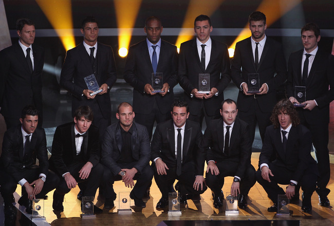 ZURICH, SWITZERLAND - JANUARY 10:  Fifa World XI award players back row l to r: Marco Van Basten who presented the award,Ronaldo,Maicon,Lucio,Gerard Pique,Iker Casillas, front row l to r: David Villa,Lionel Messi,Wesley Sneijder,Xavi,Andres Iniesta,Puyol