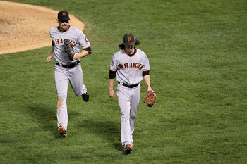 ARLINGTON, TX - NOVEMBER 01:  (L-R) Aubrey Huff #17 and Tim Lincecum #55 of the San Francisco Giants walks back to the dugout against the Texas Rangers in Game Five of the 2010 MLB World Series at Rangers Ballpark in Arlington on November 1, 2010 in Arlin