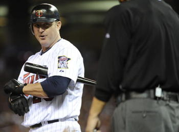 MINNEAPOLIS, MN - OCTOBER 6: Jim Thome #25 of the Minnesota Twins speaks with home plate umpire Jerry Crawford #2 during game one of the ALDS against the New York Yankees on October 6, 2010 at Target Field in Minneapolis, Minnesota. (Photo by Hannah Fosli