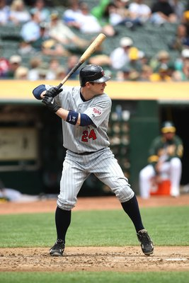 OAKLAND, CA - JUNE 11:  Joe Crede #24 of the Minnesota Twins bats against the Oakland Athletics during a Major League Baseball game on June 11, 2009 at the Oakland Coliseum in Oakland, California.  (Photo by Jed Jacobsohn/Getty Images)