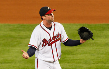 ATLANTA - OCTOBER 11:  Starting pitcher Derek Lowe #32 of the Atlanta Braves reacts after a pitch that was called a ball in the sixth inning against San Francisco Giants during Game Four of the NLDS of the 2010 MLB Playoffs at Turner Field on October 11,