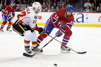 MONTREAL, CANADA - JANUARY 17:  Roman Hamrlik #44 of the Montreal Canadiens strips the puck from Jarome Iginla #12 of the Calgary Flames during the NHL game at the Bell Centre on January 17, 2011 in Montreal, Quebec, Canada.  The Canadiens defeated the Fl