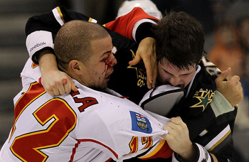 DALLAS, TX - DECEMBER 23:  Right wing Jarome Iginla #12 of the Calgary Flames fights with Jamie Benn #14 of the Dallas Stars at American Airlines Center on December 23, 2010 in Dallas, Texas.  (Photo by Ronald Martinez/Getty Images)