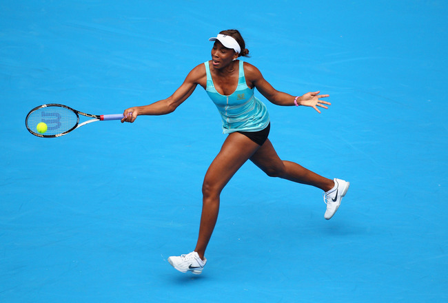 MELBOURNE, AUSTRALIA - JANUARY 17: Venus Williams of the United States of America plays a forehand in her first round match against Sara Errani of Italy during day one of the 2011 Australian Open at Melbourne Park on January 17, 2011 in Melbourne, Austral