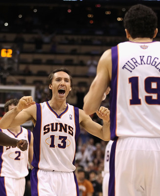 PHOENIX - DECEMBER 08:  Steve Nash #13 of the Phoenix Suns reacts after Hedo Turkoglu #19 hit a go ahead three point shot in the final moments of the NBA game against the Memphis Grizzlies at US Airways Center on December 8, 2010 in Phoenix, Arizona. The