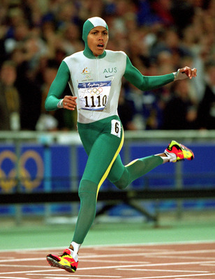 25 Sep 2000:  Cathy Freeman of Australia crosses the line to win gold in the Womens 400m Final at the Olympic Stadium on Day 10 of the Sydney 2000 Olympic Games in Sydney, Australia.  \ Mandatory Credit: Mike Powell /Allsport