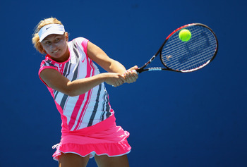 MELBOURNE, AUSTRALIA - JANUARY 24:  Daria Gavrilova of Russia plays a backhand in her first round juniors match against Storm Sanders of Australia during day seven of the 2010 Australian Open at Melbourne Park on January 24, 2010 in Melbourne, Australia.