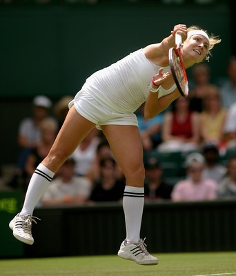 LONDON - JUNE 28:  Bethanie Mattek of USA serves to Venus Williams of USA during day three of the Wimbledon Lawn Tennis Championships at the All England Lawn Tennis and Croquet Club on June 28, 2006 in London, England.  (Photo by Daniel Berehulak/Getty Im