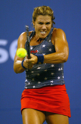 FLUSHING, NY - SEPTEMBER 5:  Jennifer Capriati of the USA returns a shot to Justine Henin-Hardenne of Belgium during the US Open at the USTA National Tennis Center, Flushing Meadows Corona Park on September 5, 2003 in Flushing, New York. (Photo by Nick La