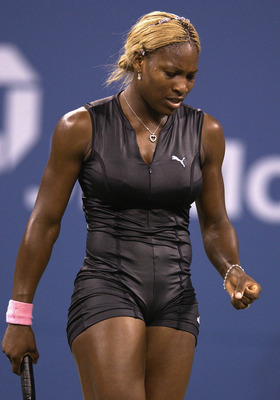 FLUSHING, NY - AUGUST 26: Serena Williams walks back to the baseline while playing Corina Morariu during the US Open August 26, 2002 at the USTA National Tennis Center in Flushing Meadows Corona Park in Flushing, New York.  (Photo by Ezra Shaw/Getty Image