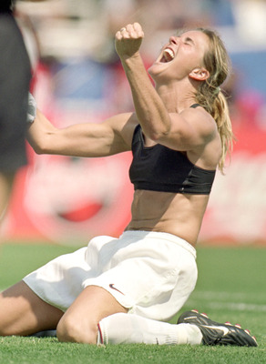 PASADENA, CA - JULY 10:  Brandi Chastain of Team USA celebrates during the Women's World Cup against Team China at The Rose Bowl on July 10, 1999 in Pasadena, California. Team USA won 5-4. (Photo by Jed Jacobsohn/Getty Images)