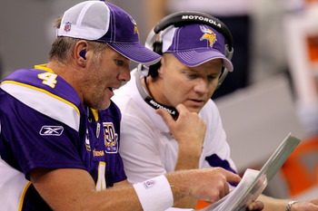 NEW ORLEANS - SEPTEMBER 09:  Quarterback Brett Favre #4 of the Minnesota Vikings talks with offensive coordinator Darrell Bevell on the bench in the second half against the New Orleans Saints at Louisiana Superdome on September 9, 2010 in New Orleans, Lou