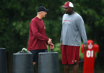 ASHBURN, VA - JULY 29:  Defensive lineman Albert Haynesworth #92 (R) works out with Defensive Coordinator Jim Haslett (L) after the Redskins first day of training camp on July 29, 2010 in Ashburn, Virginia.  (Photo by Win McNamee/Getty Images)