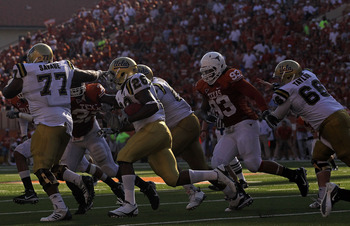 AUSTIN, TX - SEPTEMBER 25:  Tailback Malcolm Jones #28 of the UCLA Bruins runs the ball against the Texas Longhorns at Darrell K Royal-Texas Memorial Stadium on September 25, 2010 in Austin, Texas.  (Photo by Ronald Martinez/Getty Images)