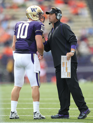 SEATTLE - SEPTEMBER 11:  Head coach Steve Sarkisian of the Washington Huskies talks to quarterback Jake Locker #10 during the game against the Syracuse Orange on September 11, 2010 at Husky Stadium in Seattle, Washington. The Huskies defeated the Orange 4