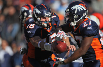 DENVER - JANUARY 02:  Quarterback Tim Tebow #15 of the Denver Broncos hands the ball off to running back Knowshon Moreno #27 against the San Diego Chargers at INVESCO Field at Mile High on January 2, 2011 in Denver, Colorado.  (Photo by Doug Pensinger/Get