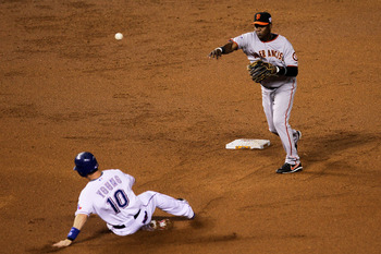 ARLINGTON, TX - OCTOBER 31:  Edgar Renteria #16 of the San Francisco Giants turns a successful double play over a sliding Michael Young #10 of the Texas Rangers on a ball hit by Josh Hamilton #32 in the bottom of the first inning of Game Four of the 2010