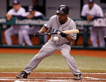 ST. PETERSBURG - SEPTEMBER 24:  Infielder Chone Figgins #9 of the Seattle Mariners attempts a bunt against the Tampa Bay Rays during the game at Tropicana Field on September 24, 2010 in St. Petersburg, Florida.  (Photo by J. Meric/Getty Images)