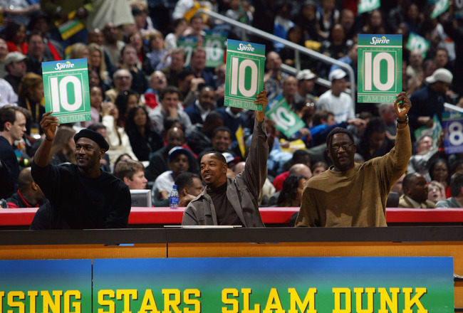 ATLANTA - FEBRUARY 8:  (L-R) Michael Jordan, Anthony 'Spud' Webb, and Dominique Wilkins judge the Sprite Rising Stars Slam Dunk Contest during the 2003 NBA All-Star Weekend at Philips Arena on February 8, 2003 in Atlanta, Georgia.  NOTE TO USER: User expr