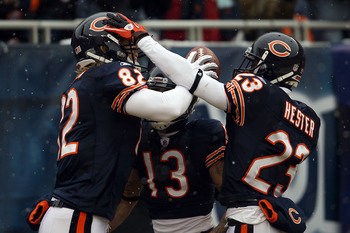 CHICAGO, IL - JANUARY 16:  Tight end Greg Olsen #82 of the Chicago Bears celebrates with Johnny Knox #13 and Devin Hester #23 after Olsen scores on a 58-yard touchdown reception in the first quarter against the Seattle Seahawks in the 2011 NFC divisional