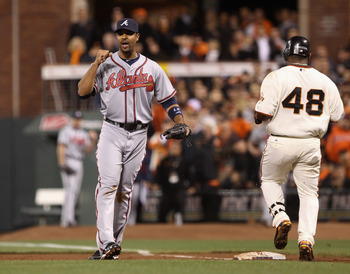 SAN FRANCISCO - OCTOBER 07:  Derrek Lee #27 of the Atlanta Braves pumps his fist after Pablo Sandoval #48 of the San Francisco Giants grounded in to a double play to end the sixth inning during game 1 of the NLDS at AT&T Park on October 7, 2010 in San Fra