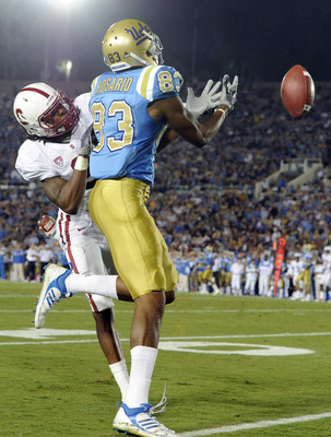PASADENA, CA - SEPTEMBER 11:  Michael Thomas #3 of the Stanford knocks the ball away from Nelson Rosario #83 of UCLA during the third quarter at the Rose Bowl on September 11, 2010 in Pasadena, California.  (Photo by Harry How/Getty Images)