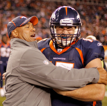 DENVER - DECEMBER 26:  Head coach Eric Studesville of the Denver Broncos celebrates with quarterback Tim Tebow #15 following the Broncos 24-23 victory over the Houston Texans at INVESCO Field at Mile High on December 26, 2010 in Denver, Colorado. (Photo b