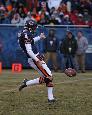 CHICAGO, IL - DECEMBER 26: Brad Maynard #4 of the Chicago Bears punts the ball against the New York Jets at Soldier Field on December 26, 2010 in Chicago, Illinois. The Bears defeated the Jets 38-34. (Photo by Jonathan Daniel/Getty Images)