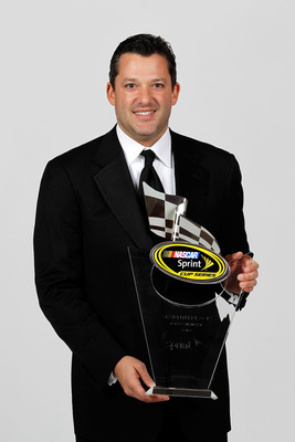Tony Stewart is looking to trade in his 7th place hardware for the Sprint Cup Trophy Jimmie Johnson has hands on.