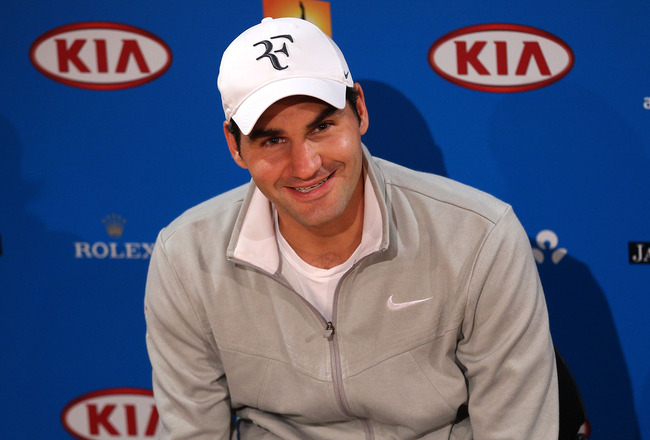 MELBOURNE, AUSTRALIA - JANUARY 17:  Roger Federer of Switzerland speaks at a press conference after his first round win against Lukas Lacko of Slovakia during day one of the 2011 Australian Open at Melbourne Park on January 17, 2011 in Melbourne, Australi