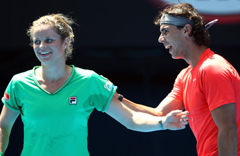 MELBOURNE, AUSTRALIA - JANUARY 16:  Rafael Nadal of Spain and Kim Clijsters of Belgium enjoy the tennis during the 'Rally For Relief' charity exhibition match ahead of the 2011 Australian Open at Melbourne Park on January 16, 2011 in Melbourne, Australia.