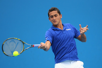 MELBOURNE, AUSTRALIA - JANUARY 17:  Nicolas Almagro of Spain plays a forehand in his/her first round match against Stephane Robert of France during day one of the 2011 Australian Open at Melbourne Park on January 17, 2011 in Melbourne, Australia.  (Photo