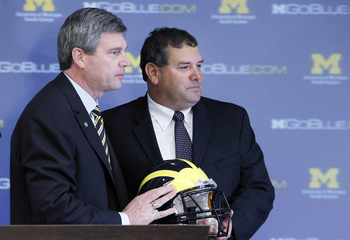 ANN ARBOR, MI - JANUARY 12:  New University of Michigan head football coach Brady Hoke (R) stands with Athletic Director Dave Brandon after being introduced to the media at the Junge Family Champions Center on January 12, 2011 in Ann Arbor, Michigan.  (Ph