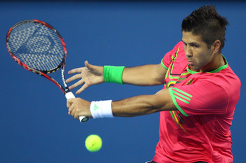 MELBOURNE, AUSTRALIA - JANUARY 17:  Fernando Verdasco of Spain plays a backhand in his first round match against Rainer Schuettler of Germany during day one of the 2011 Australian Open at Melbourne Park on January 17, 2011 in Melbourne, Australia.  (Photo