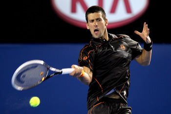 MELBOURNE, AUSTRALIA - JANUARY 17:  Novak Djkovic of Serbia plays a forehand in his first round match against Marcel Granollers of Spain during day one of the 2011 Australian Open at Melbourne Park on January 17, 2011 in Melbourne, Australia.  (Photo by C