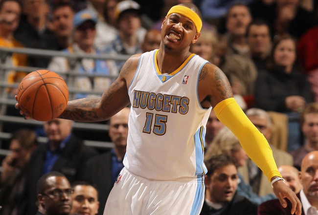 DENVER, CO - JANUARY 13:  Carmelo Anthony #15 of the Denver Nuggets reacts as the ball goes out of bounds against the Miami Heat at the Pepsi Center on January 13, 2011 in Denver, Colorado. The Nuggets defeated the Heat 130-102. NOTE TO USER: User express
