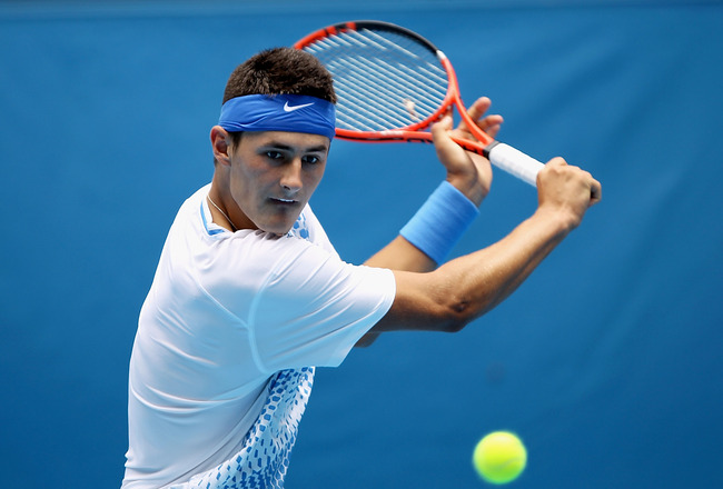 MELBOURNE, AUSTRALIA - JANUARY 18:  Bernard Tomic of Australia plays a backhand in his first round match against Jeremy Chardy of France during day two of the 2011 Australian Open at Melbourne Park on January 18, 2011 in Melbourne, Australia.  (Photo by C