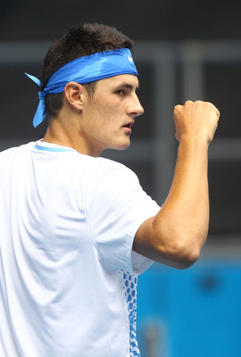 MELBOURNE, AUSTRALIA - JANUARY 18:  Bernard Tomic of Australia celebrates winning a point in his first round match against Jeremy Chardy of France during day two of the 2011 Australian Open at Melbourne Park on January 18, 2011 in Melbourne, Australia.  (