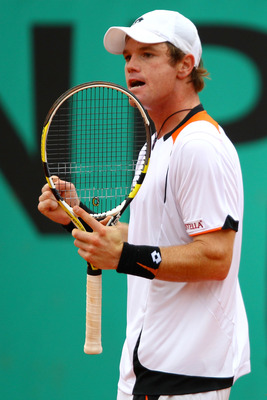 PARIS - MAY 27:  Blaz Kavcic of Slovenia celebrates a point during the men's singles second round match between Andy Roddick of the United States and Blaz Kavcic of Slovenia on day five of the French Open at Roland Garros on May 27, 2010 in Paris, France.
