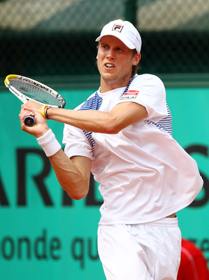 PARIS - MAY 25:  Andreas Seppi of Italy plays a backhand during the men's singles first round match between Santiago Ventura of Spain and Andreas Seppi of Italy on day three of the French Open at Roland Garros on May 25, 2010 in Paris, France.  (Photo by