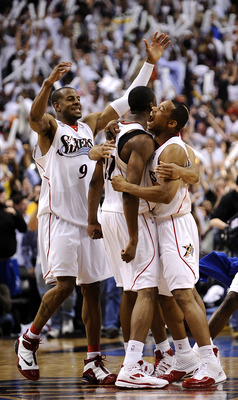 The 76ers celebrate a big win