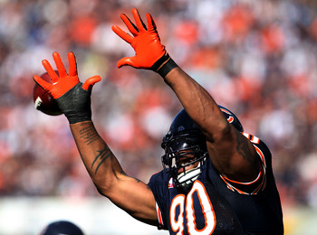 CHICAGO - OCTOBER 17: Julius Peppers #90 of the Chicago Bears leaps to get his hand on the ball against the Seattle Seahawks at Soldier Field on October 17, 2010 in Chicago, Illinois. The Seahawks defeated the Bears 23-20. (Photo by Jonathan Daniel/Getty