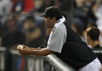 CHICAGO - AUGUST 10: Manager Ozzie Guillen #13 of the Chicago White Sox watches as his team takes on the Minnesota Twins at U.S. Cellular Field on August 10, 2010 in Chicago, Illinois. The Twins defeated the White Sox 12-6. (Photo by Jonathan Daniel/Getty