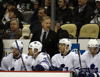 PITTSBURGH, PA - DECEMBER 08:  Toronto Maple Leafs head coach Ron Wilson talks to his players against the Pittsburgh Penguins at Consol Energy Center on December 8, 2010 in Pittsburgh, Pennsylvania.  Penguins defeated the Maple Leafs 5-2.  (Photo by Justi