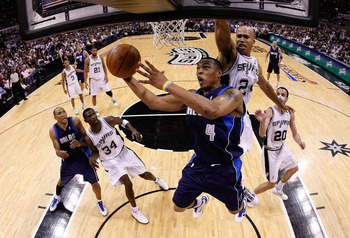 SAN ANTONIO - APRIL 29:  Forward Caron Butler #4 of the Dallas Mavericks takes a shot against Richard Jefferson #24 of the San Antonio Spurs in Game Six of the Western Conference Quarterfinals during the 2010 NBA Playoffs at AT&T Center on April 29, 2010
