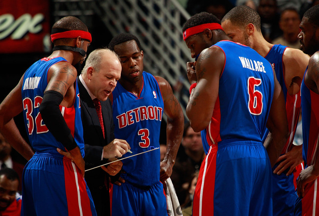 NEW ORLEANS, LA - DECEMBER 08:  Head coach John Keuster of the Detroit Pistons talks with his team during a time out against the New Orleans Hornets at the New Orleans Arena on December 8, 2010 in New Orleans, Louisiana.  NOTE TO USER: User expressly ackn