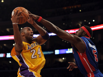 Ben Wallace blocking the shot of NBA Champion Kobe Bryant.