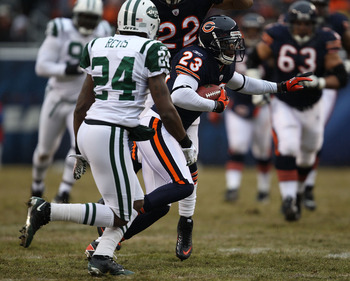 CHICAGO, IL - DECEMBER 26: Devin Hester #23 of the Chicago Bears runs as Darrelle Revis #24 of the New York Jets pursues at Soldier Field on December 26, 2010 in Chicago, Illinois. The Bears defeated the Jets 38-34. (Photo by Jonathan Daniel/Getty Images)